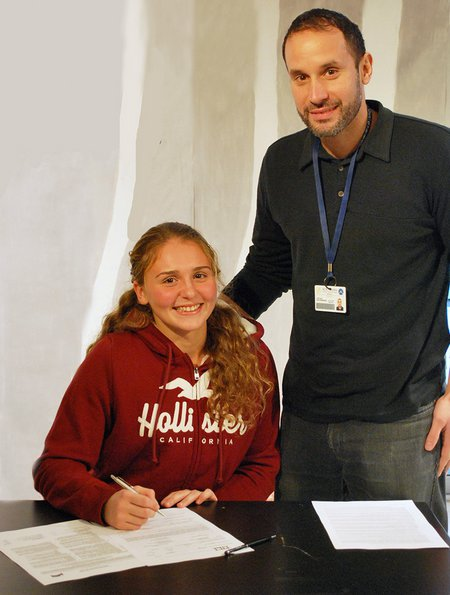Alexandra with her counselor Stelios Kalogridakis signing the Letter of Intent